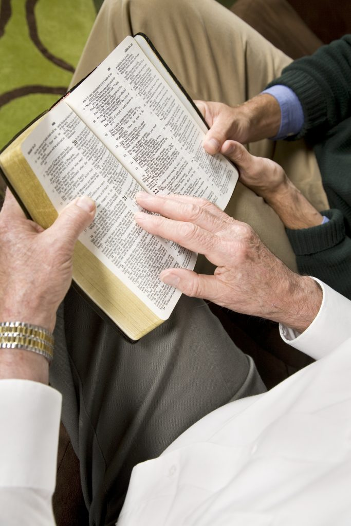 older men studying bible
